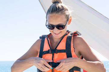 Happy young girl Parasailing in Dominicana beach in summer. Couple under parachute hanging mid air. Having fun. Tropical Paradise. Positive human emotions, feelings, joy.