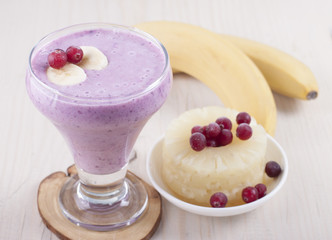 Smoothies of banana, canned pineapple and frozen cranberry  .