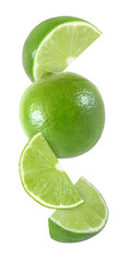 hanging, falling and flying piece of lime fruits isolated on white background with clipping path