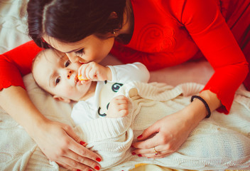 young  mother embraces her funny  child