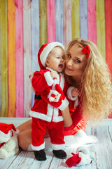 beautiful mom holding her  little Santa Claus
