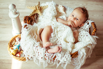 great happy baby lying on a white kerchief
