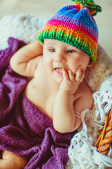amazing  baby lying in a wooden basket