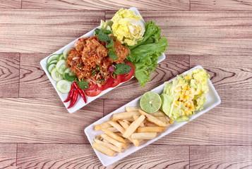 Spicy fried chicken salad (Yum Kai Zap in Thai)