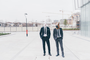 Two contemporary businessman wearing masks