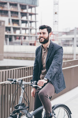 Contemporary businessman riding bicycle