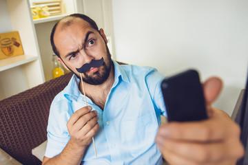 Caucasian man business selfie in cafe city