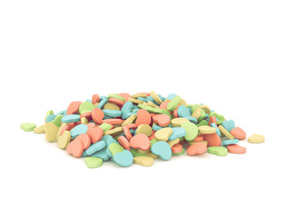 Isolated closeup of different heart shaped drugs. Soft colorful love pills