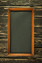 The brown frame on a wooden background. grunge texture