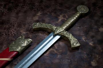 sword on a wooden dark background