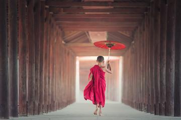 Buddhist novice is walking in temple, Myanmar