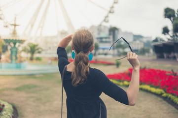 Woman looking at ferris wheel