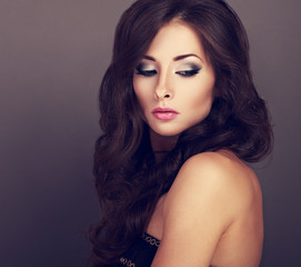 Beautiful bright makeup woman with curly long hair style and pin
