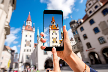 Photographing with smart phone the old town hall in Munich city, Germany