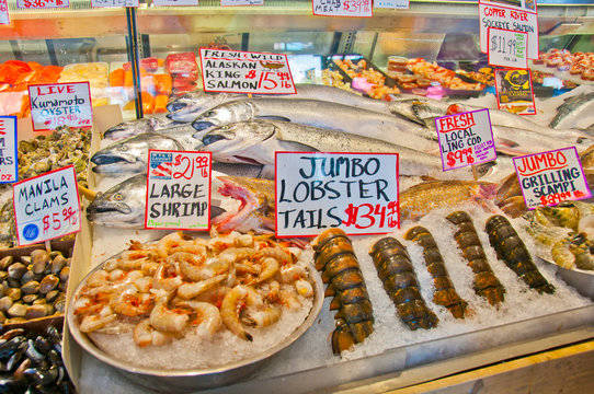 Variety of fresh seafood displayed on market stall.