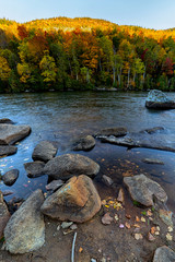 Fall foliage by Cascade lake in Adirondack mountains, NY
