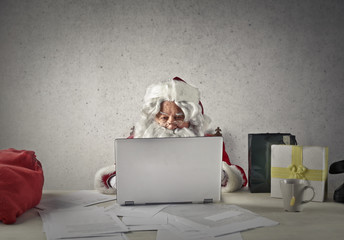 Santa Claus behind the desk