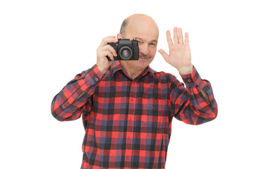 elderly man looks into the camera viewfinder