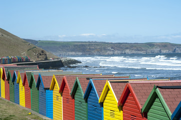 Brightly coloured beach huts and seafront