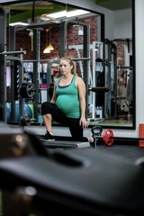 Pregnant woman performing exercise