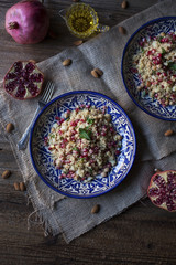 Couscous with chickpeas, almonds and pomegranate