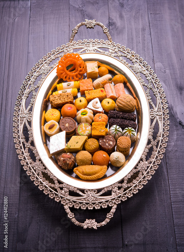 Indian assorted Sweets or sweet Food or mithai in decorative plate on diwali & Indian assorted Sweets or sweet Food or mithai in decorative plate ...