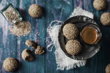 Tahini cookies. Set on a vintage wooden table
