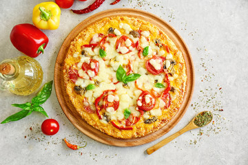 Tasty pizza with ingredients on table