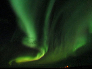 Spectacular Northern Lights Dancing in the Winter Sky of South Iceland