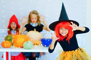 Happy group of children in costumes during Halloween party