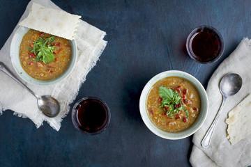 Red Lentil Soup with Sun Dried Tomato Arugula Pesto
