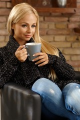 Relaxed woman with cup of tea