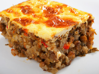 Vegetarian moussaka from lentils, onion, peppers and eggs. Horiz