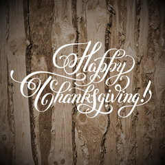 Happy Thanksgiving handwritten lettering inscription on wood bac
