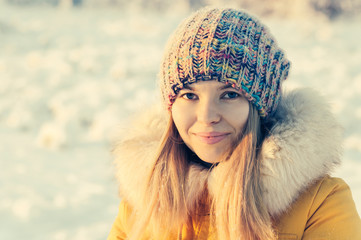 Young Woman Face in winter hat fashion fur clothing outdoor Travel Lifestyle snow nature on background