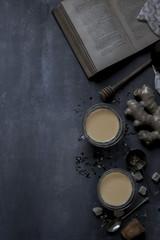 Chai tea and historic book