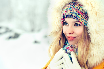 Winter Woman Face in hat and fur hood fashion outdoor Lifestyle vacations snow nature on background