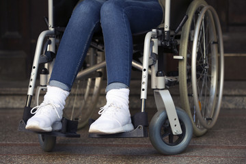 closeup of woman in wheelchair at an entrance