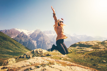 Happy Woman jumping up Flying levitation with mountains landscape on background Lifestyle Travel emotions success concept outdoor