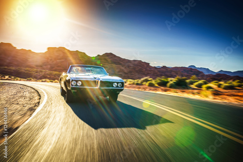 Wall mural driving fast through desert in vintage hot rod car