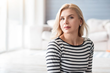 Blond lady against blurred background