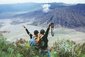 pretty girl the tourist, the hipster with a backpack posing on a volcano and looking into the distance,the atmosphere of adventure,of searching,of wandering,a portrait of the traveler,outdoor,close up