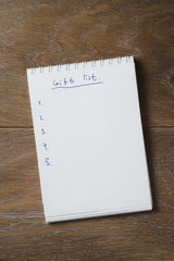 things to do list on notepad on wood table