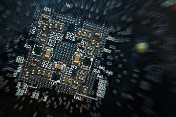 Close up of a printed green computer circuit board with radial b