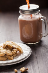 Homemade chocolate chip oatmeal cookies with hot chocolate