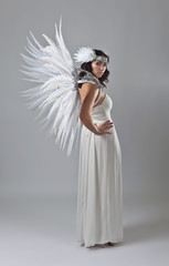 Beautiful woman in white dress with angel wings