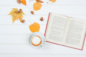 Top view of cup of cappuccino on autumn background.