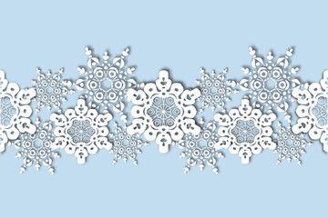 Seamless pattern lace from snowflakes . The Blizzard in the sky.