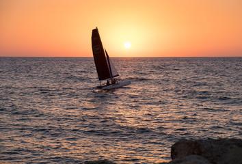 Catamaran in Mediterranean Sea at sunset. Tel-Aviv. Israel