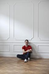 Smiling man sitting inside a room